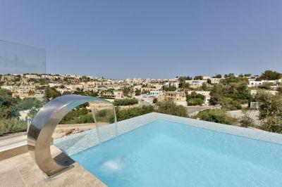 Villa carob hill with modern design and infinity pool for Pool design malta